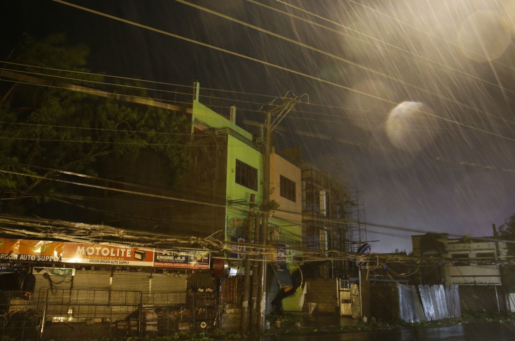 Strong winds and rain batter buildings and business establishments as Typhoon Mangkhut hits Tuguegarao city, Cagayan province, northeastern Philippine