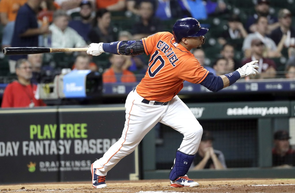 Houston Astros' Yuli Gurriel hits an RBI single against the Arizona Diamondbacks during the first inning of a baseball game Friday, Sept. 14, 2018, in