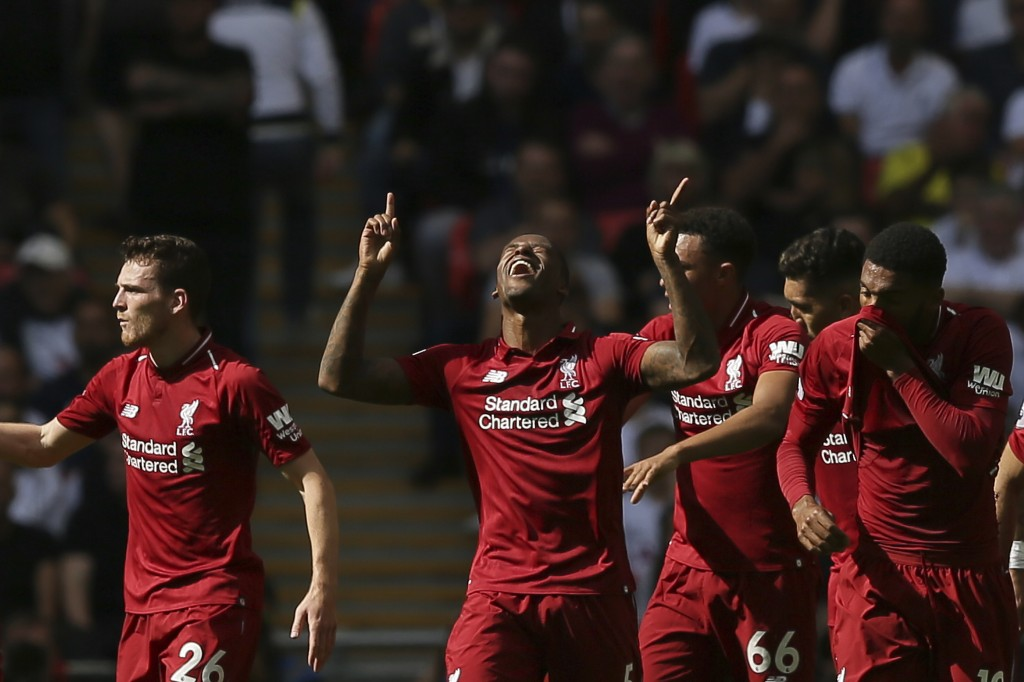 Liverpool's Georginio Wijnaldum, center celebrates scoring his side opening goal during the English Premier League soccer match between Tottenham Hots