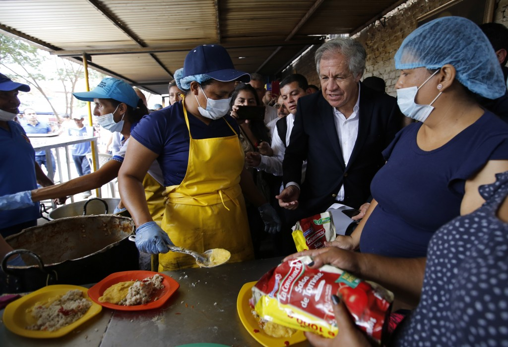 "Organization of American States Secretary-General Luis Almagro talks to Venezuelan migrants at the ""Divina Providencia"" migrant shelter, in La Parada,"