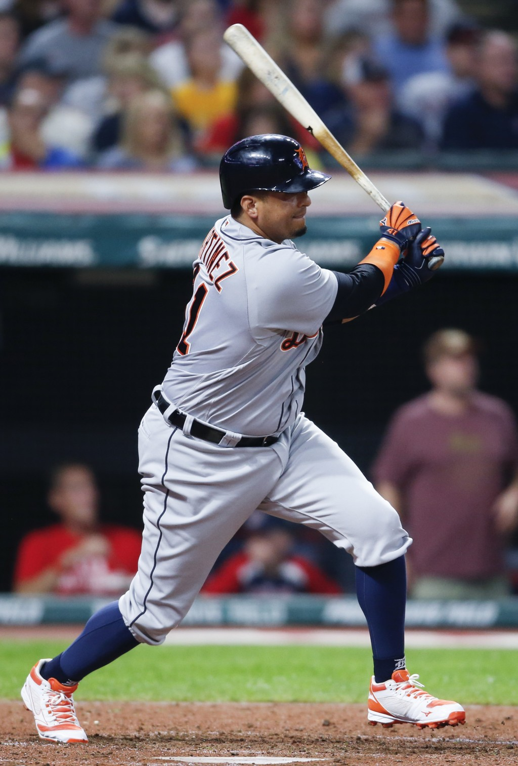 Detroit Tigers' Victor Martinez hits a one run double off Cleveland Indians' Andrew Miller during the seventh inning of a baseball game, Friday, Sept.