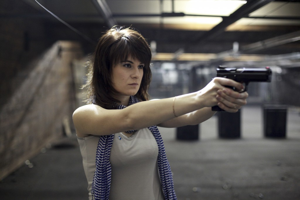 FILE In this file photo taken on Sunday, April 22, 2012, Maria Butina, a gun-rights activist poses for a photo at a shooting range in Moscow, Russia. ...