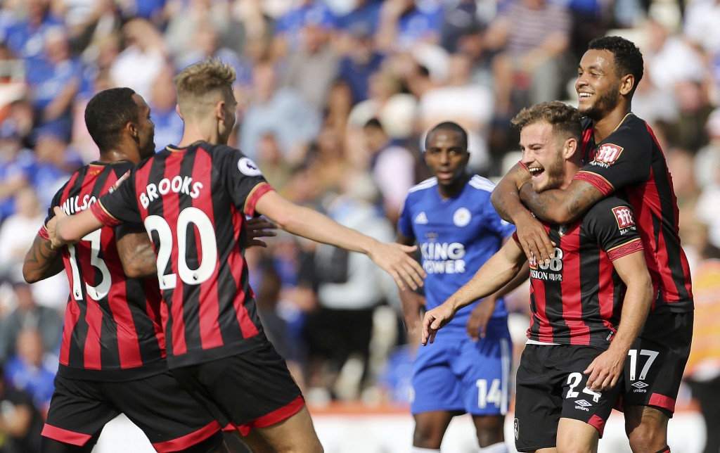 Bournemouth's Ryan Fraser, second right, celebrates scoring his side's second goal of the game with teammates, during the English Premier League socce