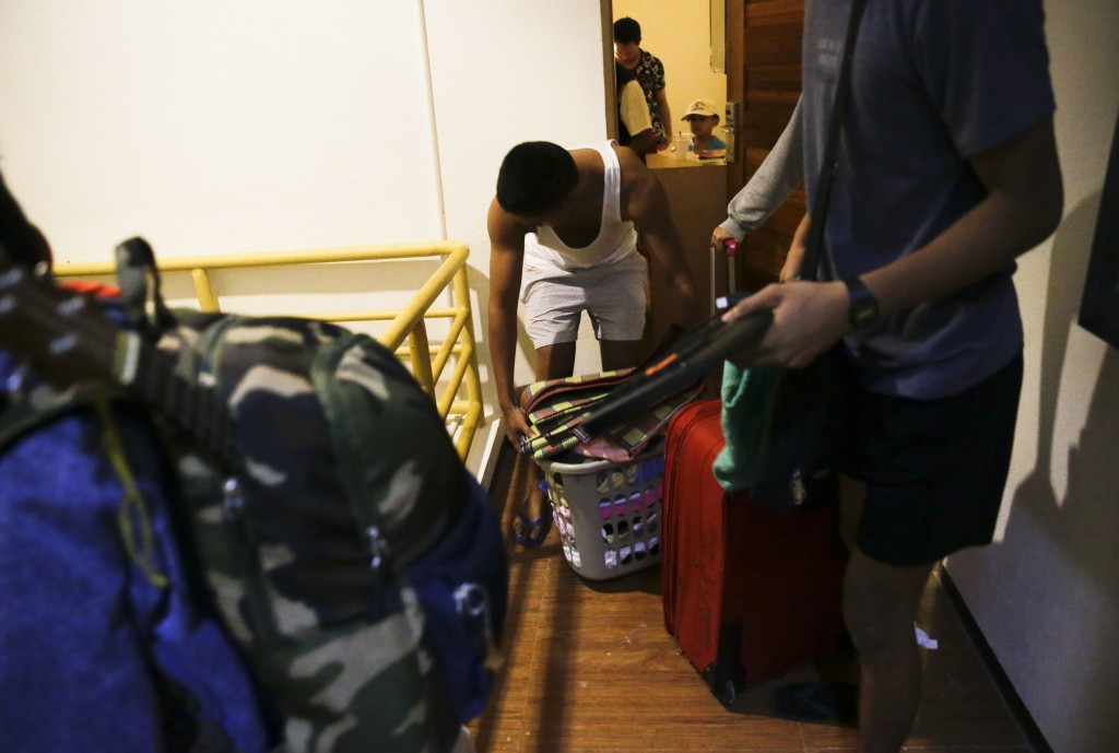 Guests prepare to transfer rooms after the roof was partly damaged due to strong winds from Typhoon Mangkut in Tuguegarao city, Cagayan province, nort