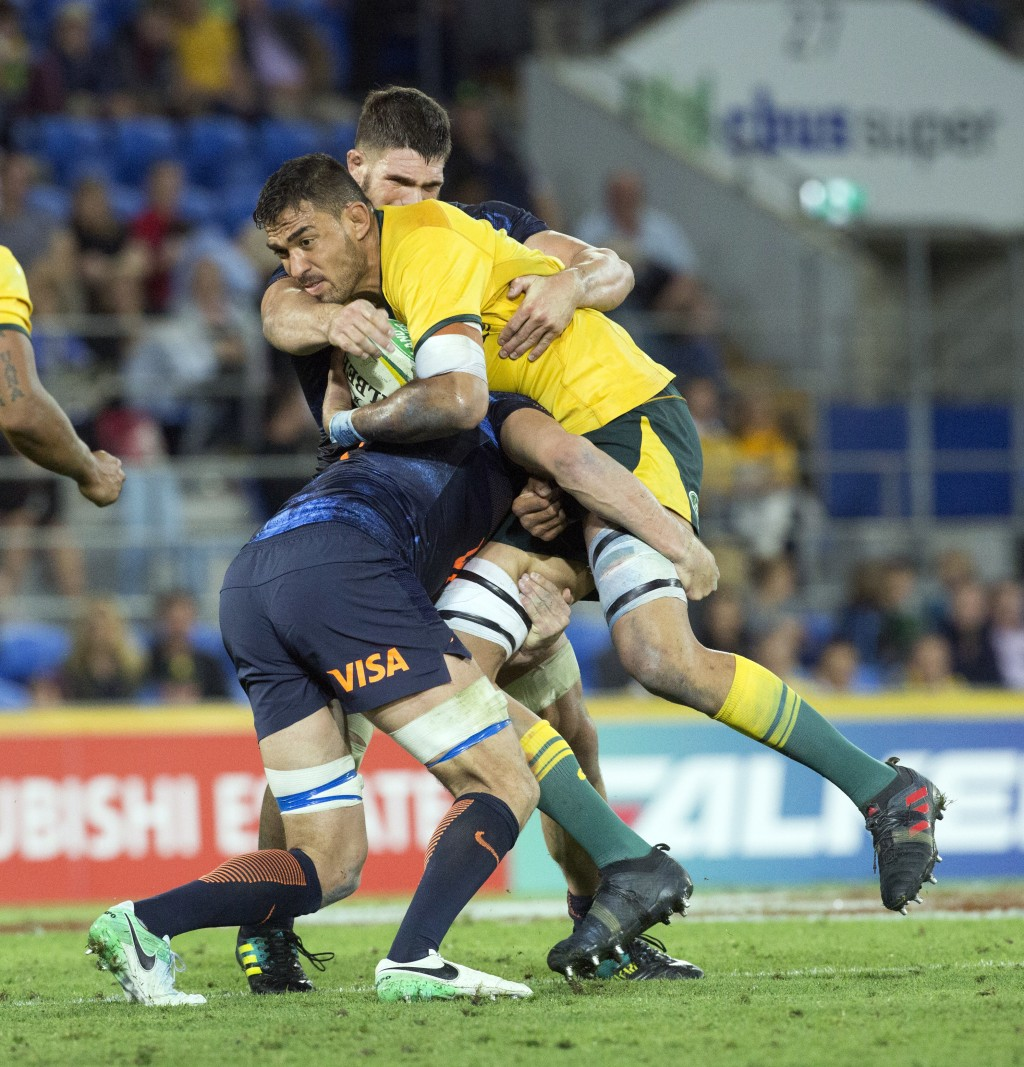 Argentina players tackles Australia's Rory Arnold during the rugby union test match between Australia and Argentina, in the Gold Coast, Australia, Sat...