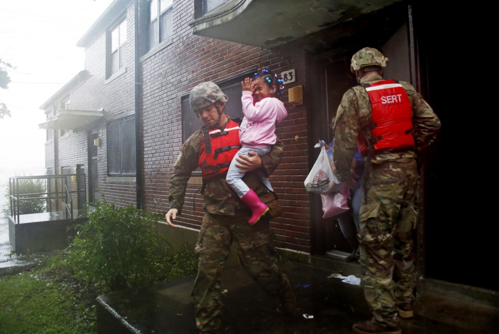 A rescue team from the North Carolina National Guard 1/120th battalion evacuates a family as the rising floodwaters from Hurricane Florence threatens