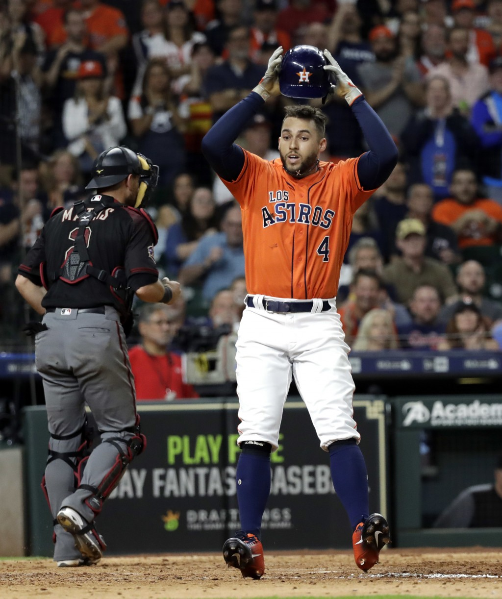 Houston Astros' George Springer reacts after a strike three call to end the seventh inning of a baseball game against the Arizona Diamondbacks Friday,...