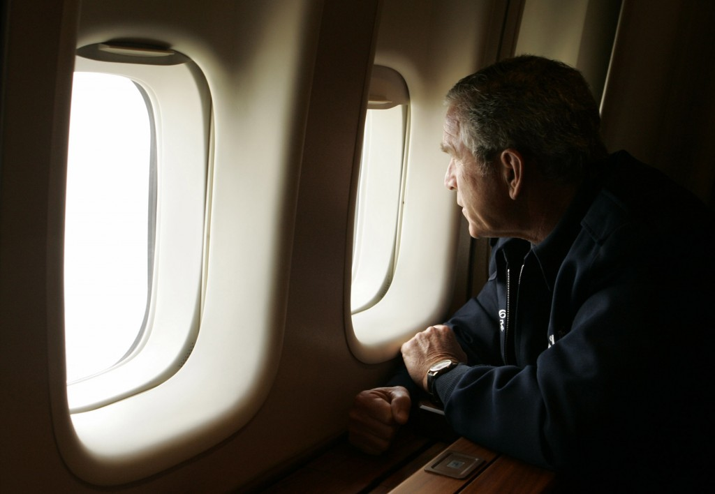 FILE - In this Aug, 31, 2005 file photo, President Bush looks out the window of Air Force One inspecting damage from Hurricane Katrina while flying ov