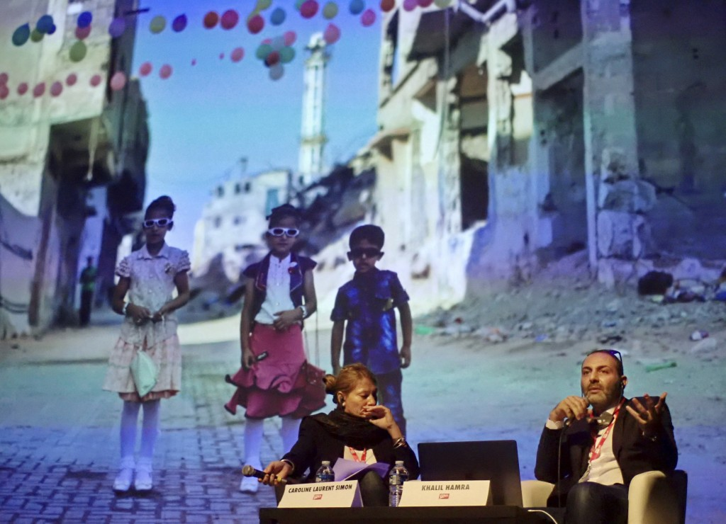 In this Sept. 6, 2018 photo, Associated Press photojournalist Khalil Hamra speaks about his work in Gaza, during a presentation moderated by Caroline