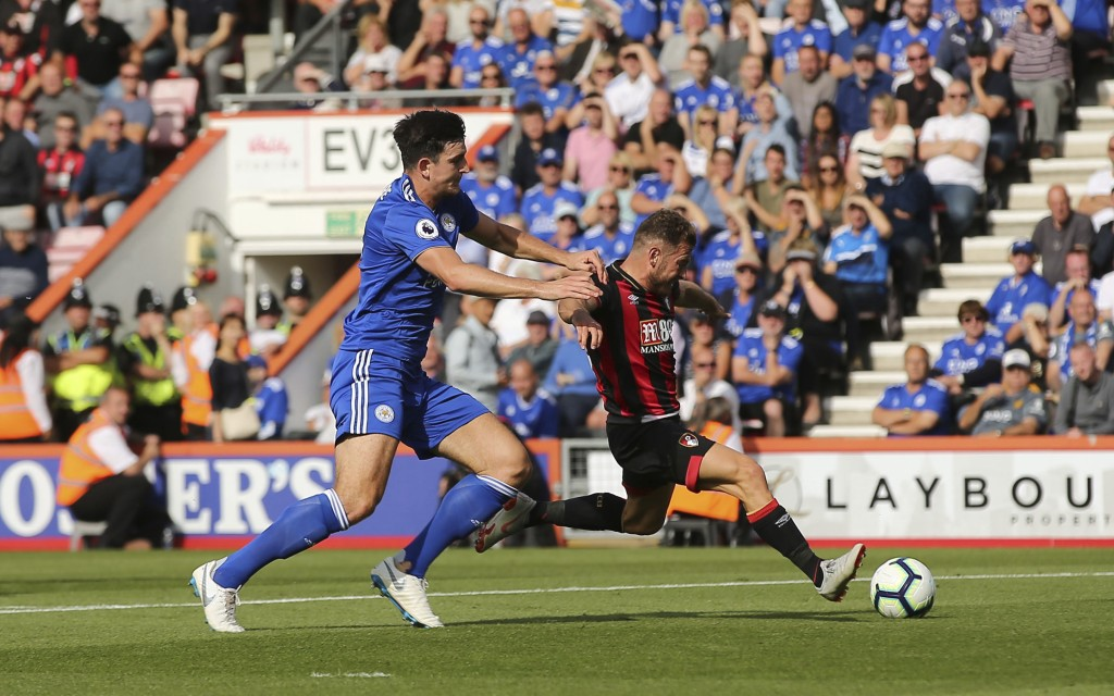 Bournemouth's Ryan Fraser gets past Leceister's Harry Maguire to score his side's second goal of the game, during the English Premier League soccer ma