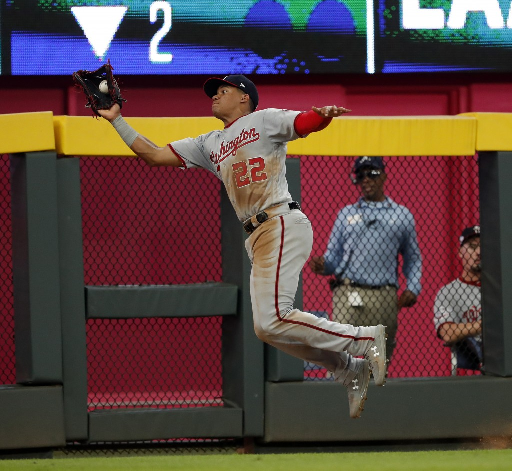 Washington Nationals left fielder Juan Soto (22) makes a catch on a fly ball off the bat of Atlanta Braves' Freddie Freeman in the second inning of a