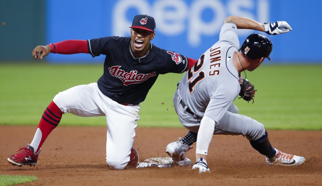 Detroit Tigers' JaCoby Jones, right, steals second base as Cleveland Indians' Francisco Lindor attempts a tag during the eighth inning of a baseball g