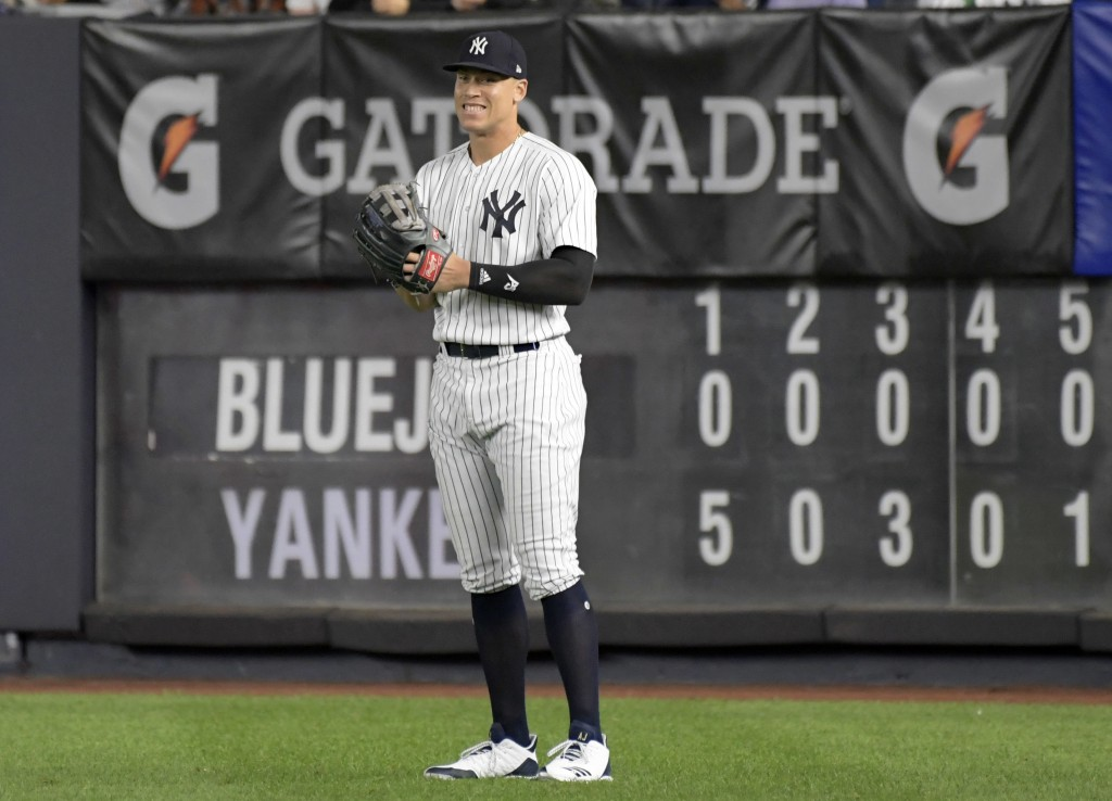 New York Yankees right fielder Aaron Judge smiles after coming into the baseball game in the eighth inning against the Toronto Blue Jays Friday, Sept.