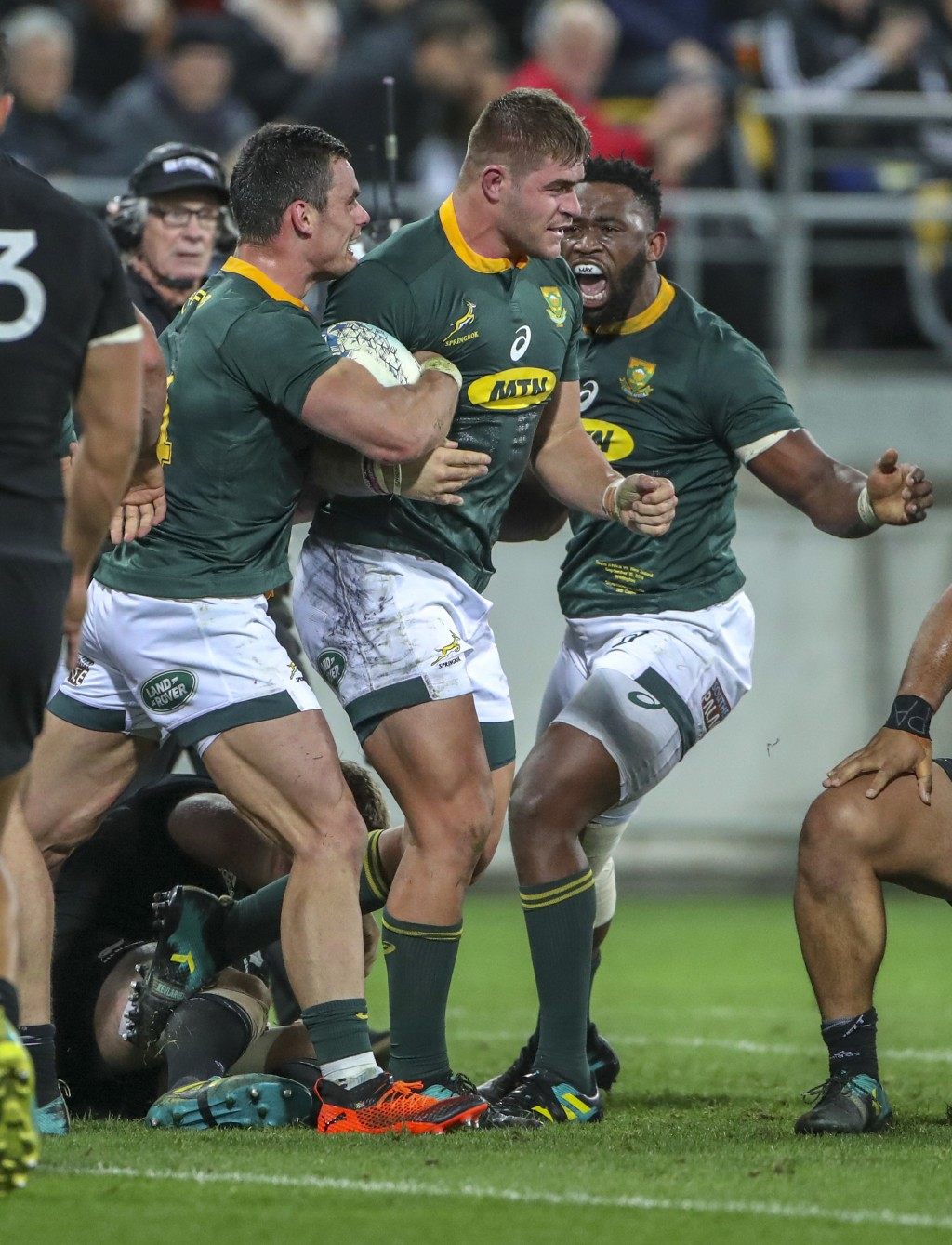 South Africa's Malcolm Marx, center, is congratulated on his try by teammates Jesse Kriel and Siya Kolisi, right, during a rugby championship test mat