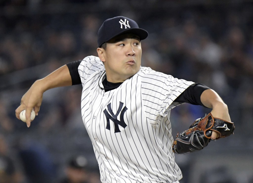 New York Yankees pitcher Masahiro Tanaka delivers the ball to the Toronto Blue Jays during the first inning of a baseball game Friday, Sept.14, 2018,