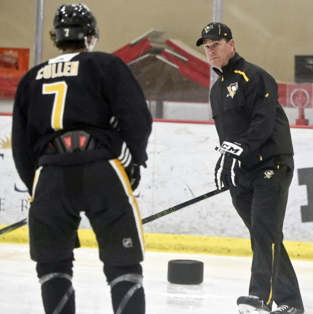 Pittsburgh Penguins head coach Mike Sullivan, right, skates beside Matt Cullen during NHL hockey training camp, Friday, Sept. 14, 2018, in Cranberry T