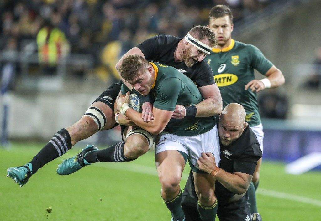 South Africa's Malcolm Marx is tackled by New Zealand's Kieran Read, left, and Owen Franks during a rugby championship test match between South Africa