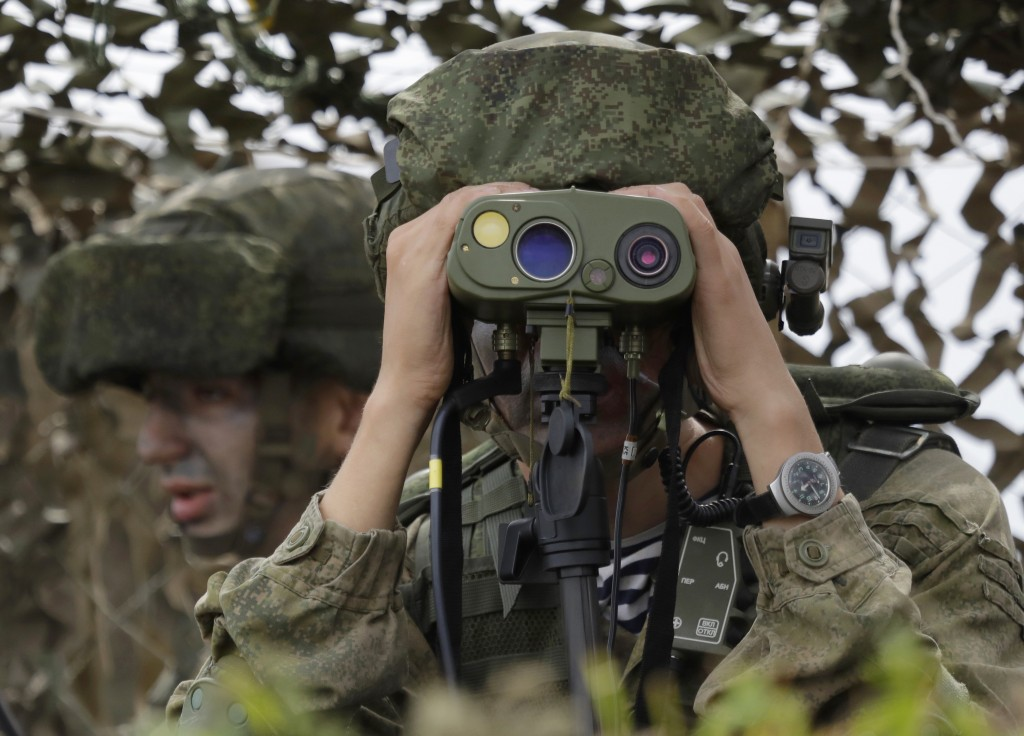 """A Russian officer watches during Russian military maneuvers Vostok 2018 on the training ground """"Klerk,"""" about 50 kilometers (31 miles) south of Vladiv"""
