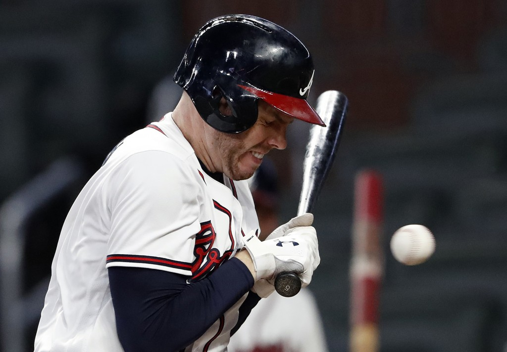 Atlanta Braves' Freddie Freeman is hit by a pitch from Washington Nationals relief pitcher Sammy Solis in the eighth inning of a baseball game Friday,