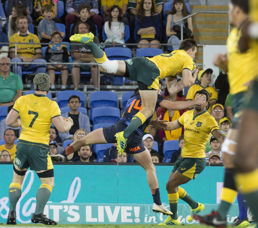 Argentina's Delguy Bautiista (14) and Australia's Dane Haylett-Petty leap high to catch the ball during their rugby union test match in the Gold Coast