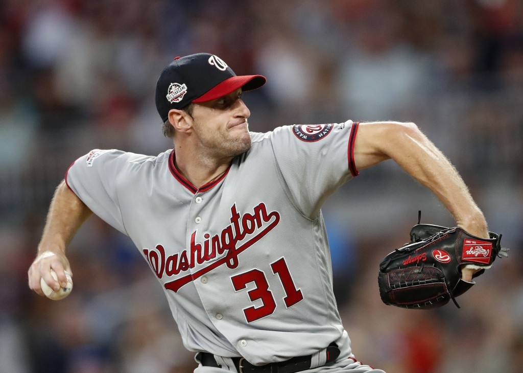 Washington Nationals starting pitcher Max Scherzer (31) works against the Atlanta Braves in the first inning of a baseball game Friday, Sept. 14, 2018