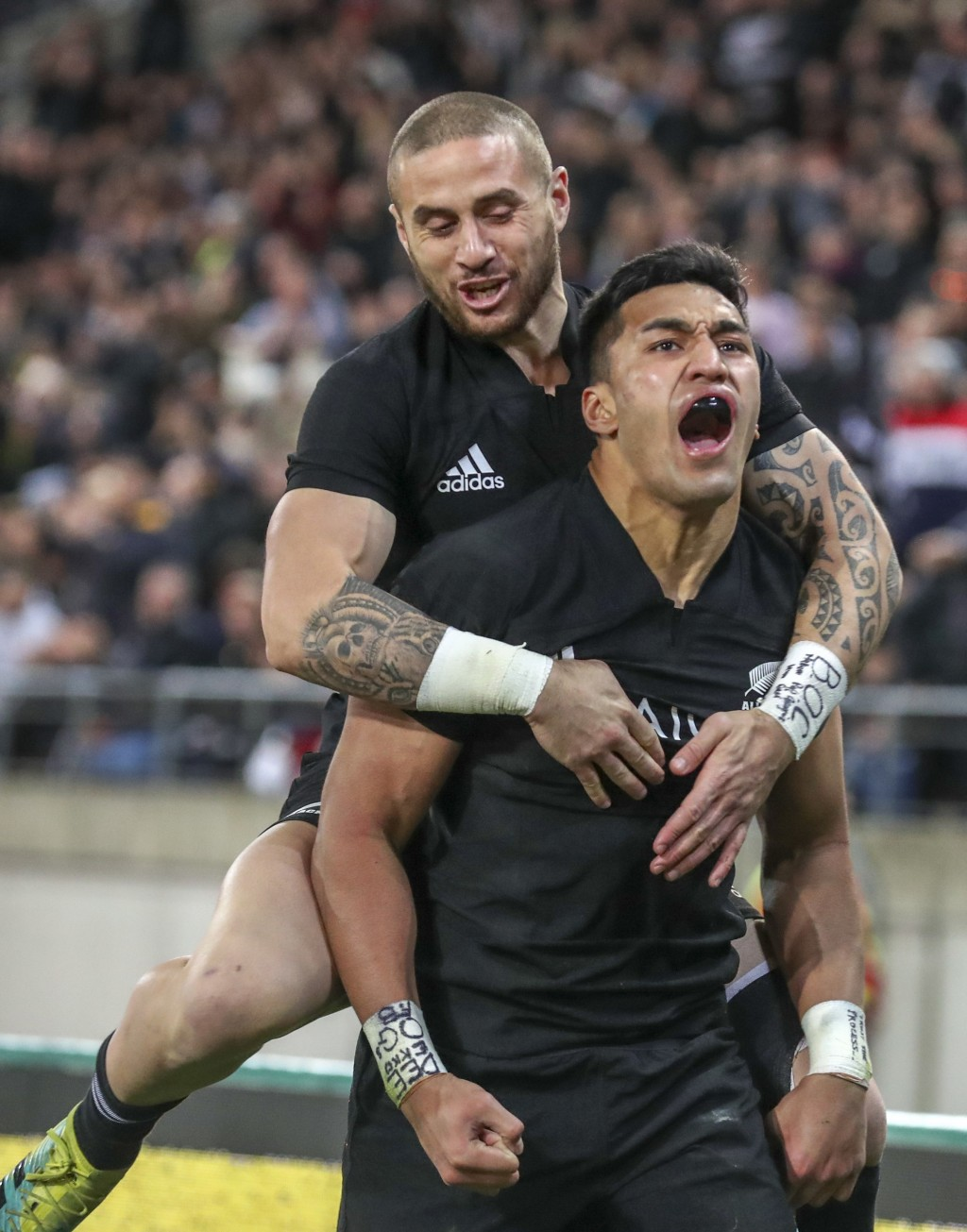 New Zealand's Rieko Ioane, right, celebrates his try with teammate TJ Perenara during a rugby championship test match between South Africa and New Zea