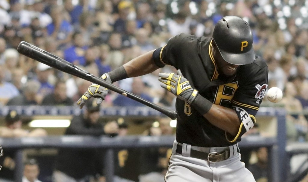 Pittsburgh Pirates' Starling Marte is hit by a pitch during the seventh inning of a baseball game against the Milwaukee Brewers Friday, Sept. 14, 2018