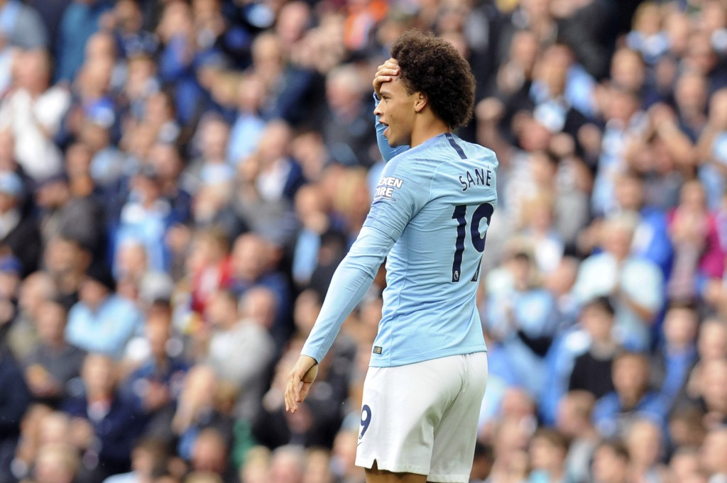 Manchester City's Leroy Sane reacts after scoring his side's first goal during the English Premier League soccer match between Manchester City and Ful