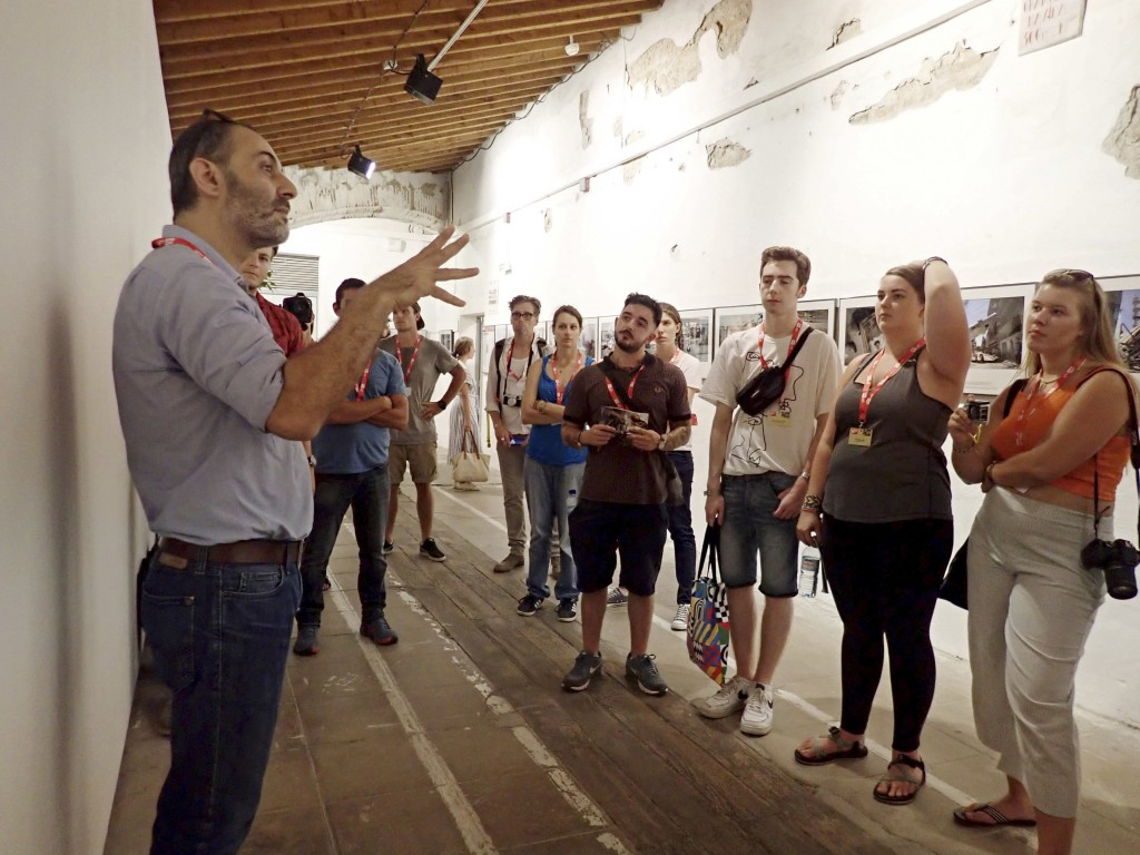 In this Sept. 5, 2018 photo, Associated Press photojournalist Khalil Hamra speaks to students during his 'Why Gaza?' exhibition at the 30th annual Vis