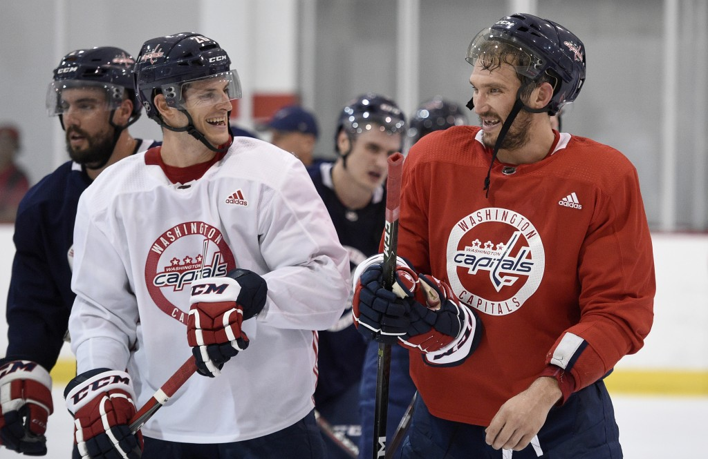 Washington Capitals left wing Alex Ovechkin, right, of Russia, laughs with Nic Dowd, left, as they leave the ice at NHL hockey training camp, Friday,