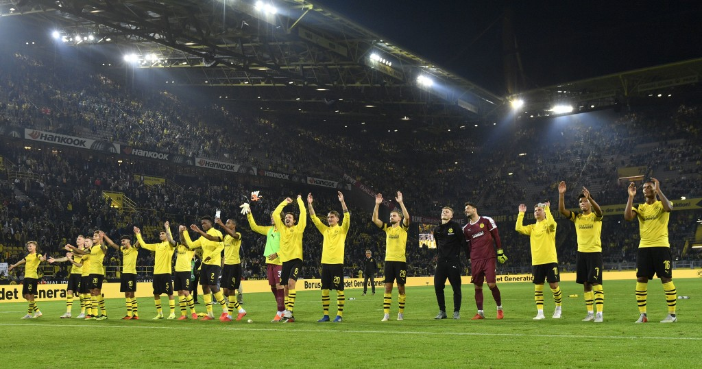 Dortmund's team celebrates after winning the German Bundesliga soccer match between Borussia Dortmund and Eintracht Frankfurt in Dortmund, Germany, Fr...