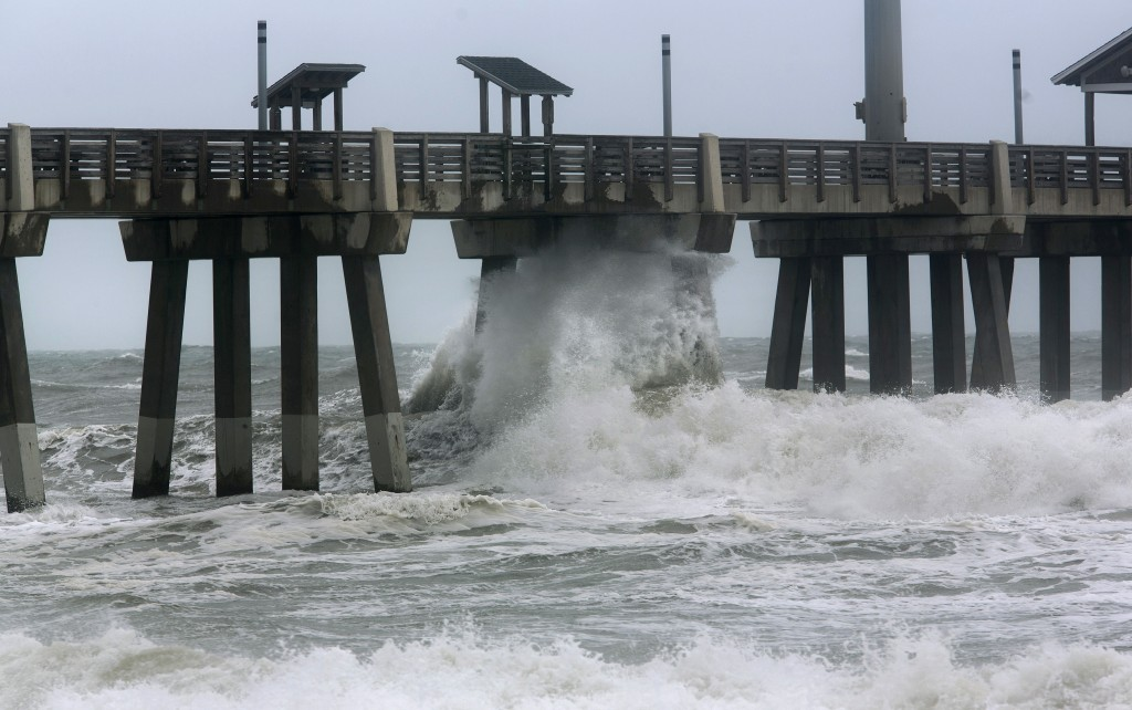 Large waves crash under Jennette's Pier in Nags Head N.C. at high tide as Hurricane Florence makes landfall further south, Friday, Sept, 14, 2018. (L.