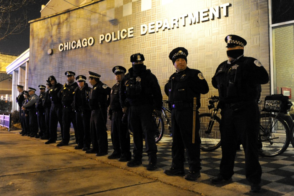 FILE - In this Tuesday, Nov. 24, 2015 file photo, police officers line up outside the District 1 central headquarters at 17th and State streets in Chi