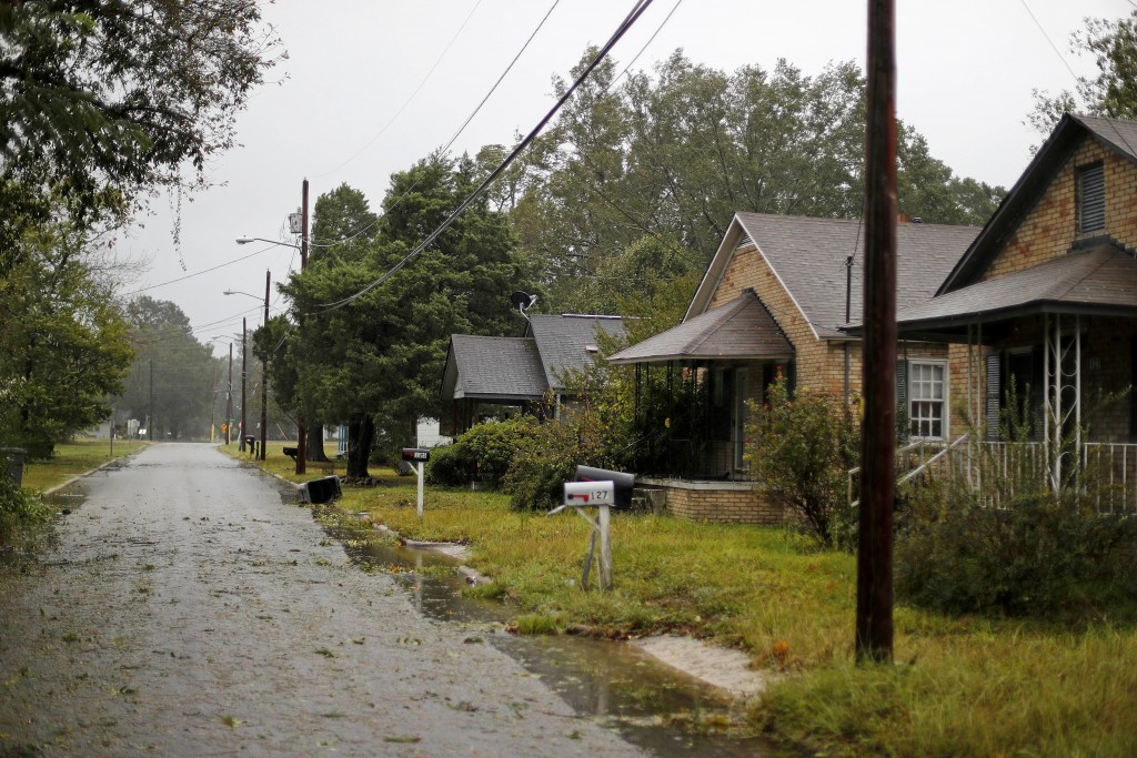 Homes stand vacant as Hurricane Florence threatens flooding to the neighborhood in Lumberton, N.C., Friday, Sept. 14, 2018. The rural town, battered b