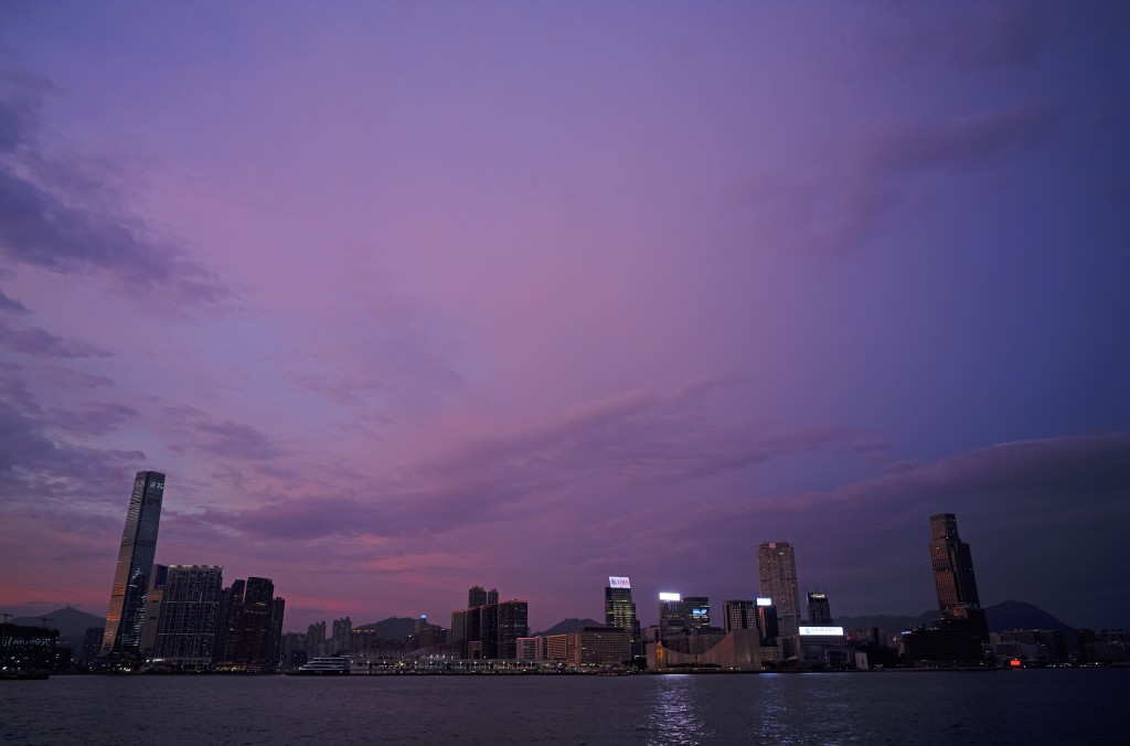 The skyline of the Kowloon area is silhouetted at sunset as typhoon Mangkhut is approaching Hong Kong Saturday, Sept. 15, 2018. Typhoon Mangkhut slamm...