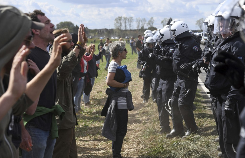 Protesters are observed by the Police as they try to enter the Hambach forest in Kerpen, Germany, Saturday, Sept. 15, 2018. German energy company RWE ...