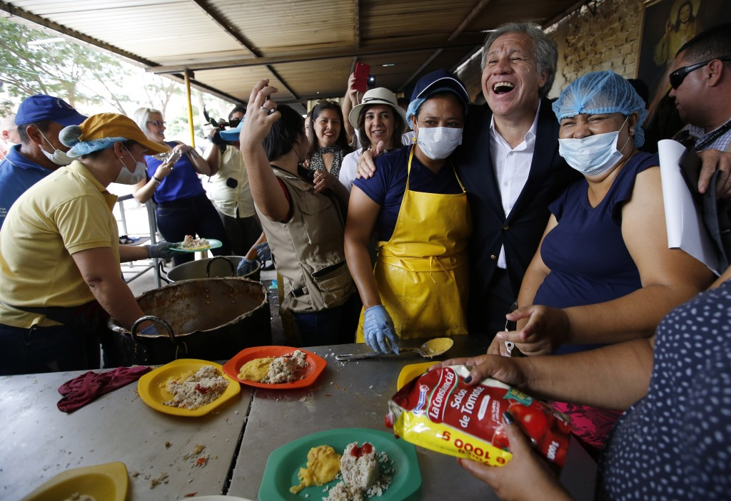 "Organization of American States Secretary-General Luis Almagro greets Venezuelan migrants at the ""Divina Providencia"" migrant shelter, in La Parada, C"
