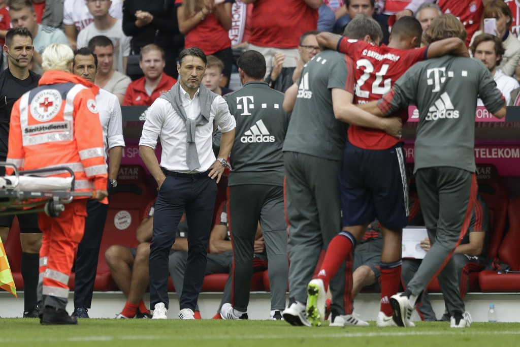 Bayern coach Niko Kovac watches Corentin Tolisso leaving the field injured during the German Bundesliga soccer match between FC Bayern Munich and Baye