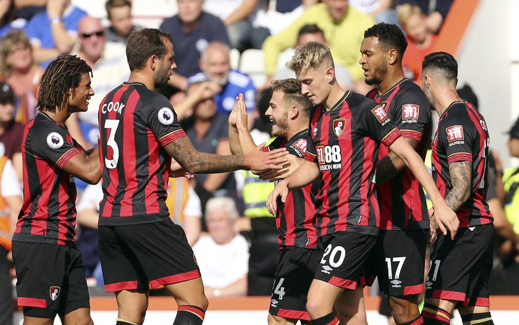 Bournemouth's Ryan Fraser, centre right,  celebrates with teammates after scoring his side's first goal of the game during the English Premier League