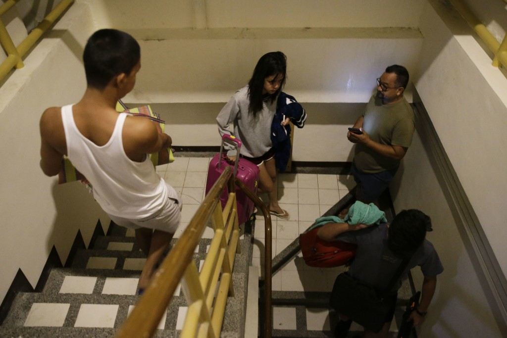 Guests prepare to transfer rooms after the roof of their hotel was partly damaged due to strong winds from Typhoon Mangkut in Tuguegarao city, Cagayan
