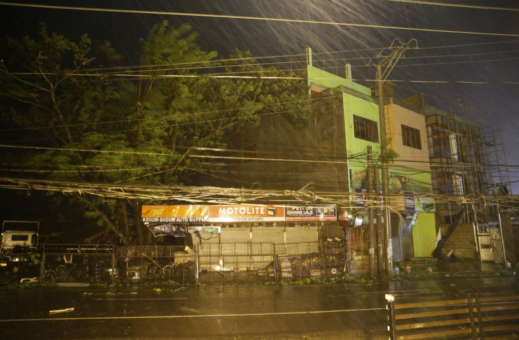 Strong winds and rain batter a town as Typhoon Mangkhut hits Tuguegarao city, Cagayan province, northeastern Philippines on Saturday, Sept. 15, 2018.