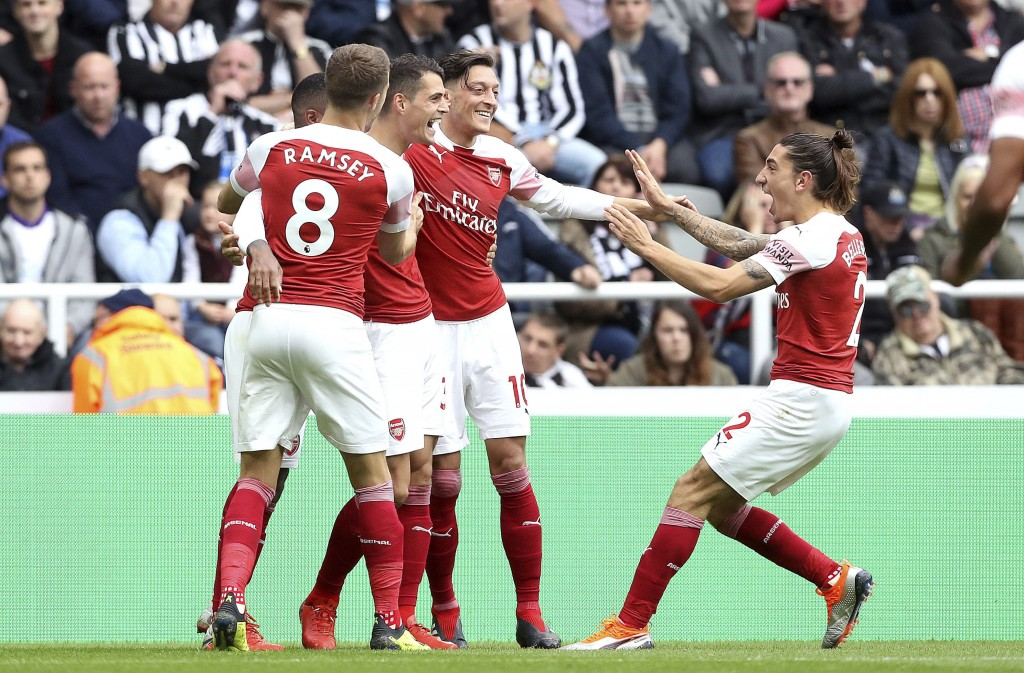 Arsenal's Granit Xhaka, third left celebrates scoring his side's first goal of the game with teammates, during the English Premier League soccer match...