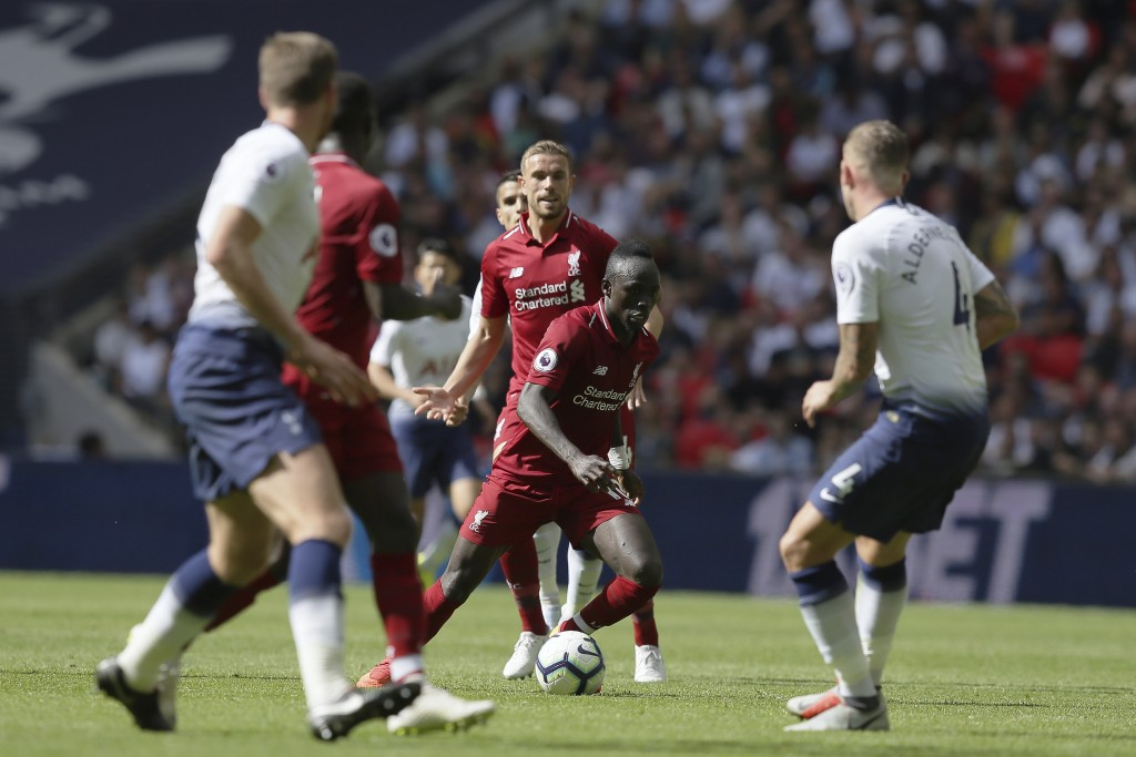 Liverpool's Sadio Mané, center, vies the ball during the English Premier League soccer match between Tottenham Hotspur and Liverpool at Wembley Stadiu
