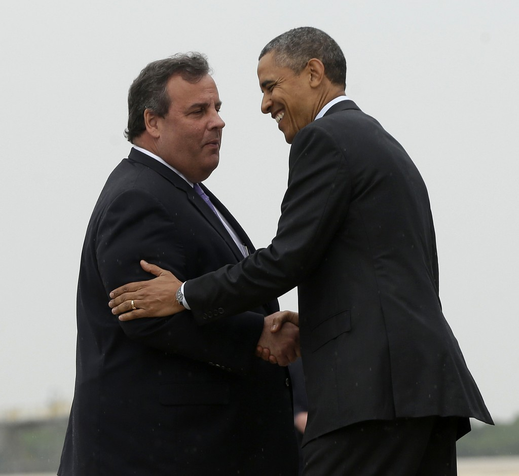 FILE - In this May 28, 2013 file photo, New Jersey Gov. Chris Christie greets President Barack Obama upon his arrival at McGuire Air Force Base, N.J.