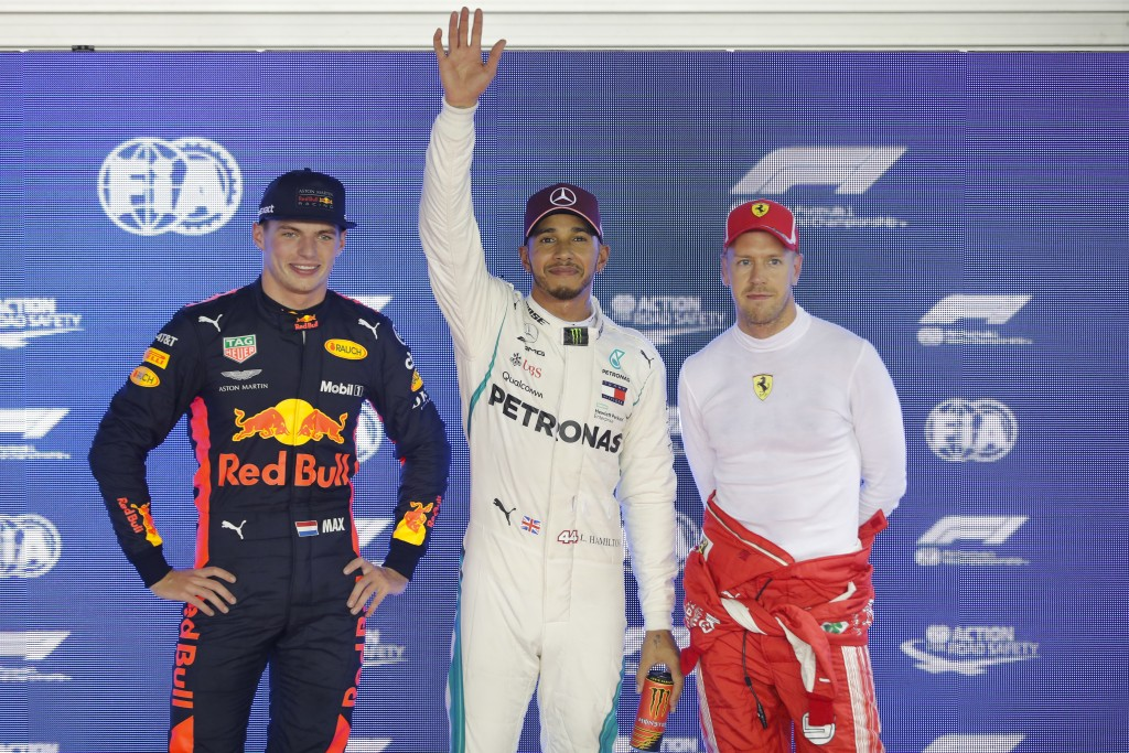 From left, Red Bull driver Max Verstappen of the Netherlands, Mercedes driver Lewis Hamilton of Britain, Ferrari driver Sebastian Vettel of Germany po