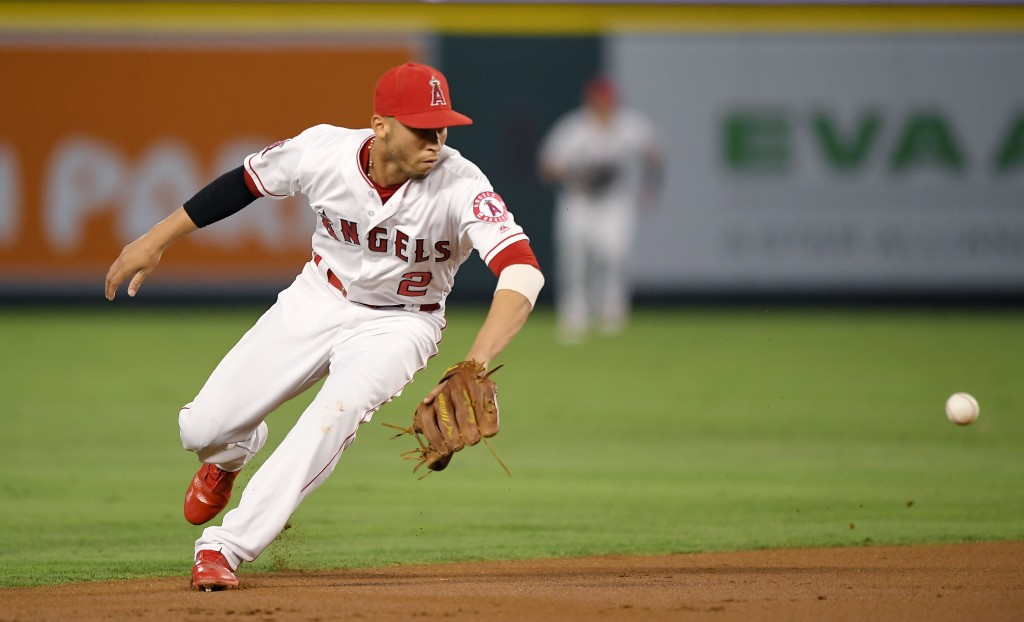 Los Angeles Angels shortstop Andrelton Simmons fields a ball hit by Seattle Mariners' Robinson Cano before throwing him out at first during the first