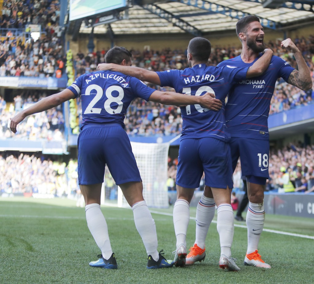 Chelsea's Cesar Azpilicueta, left, and Olivier Giroud, right, celebrate with Eden Hazard who scored his side's first goal during their English Premier