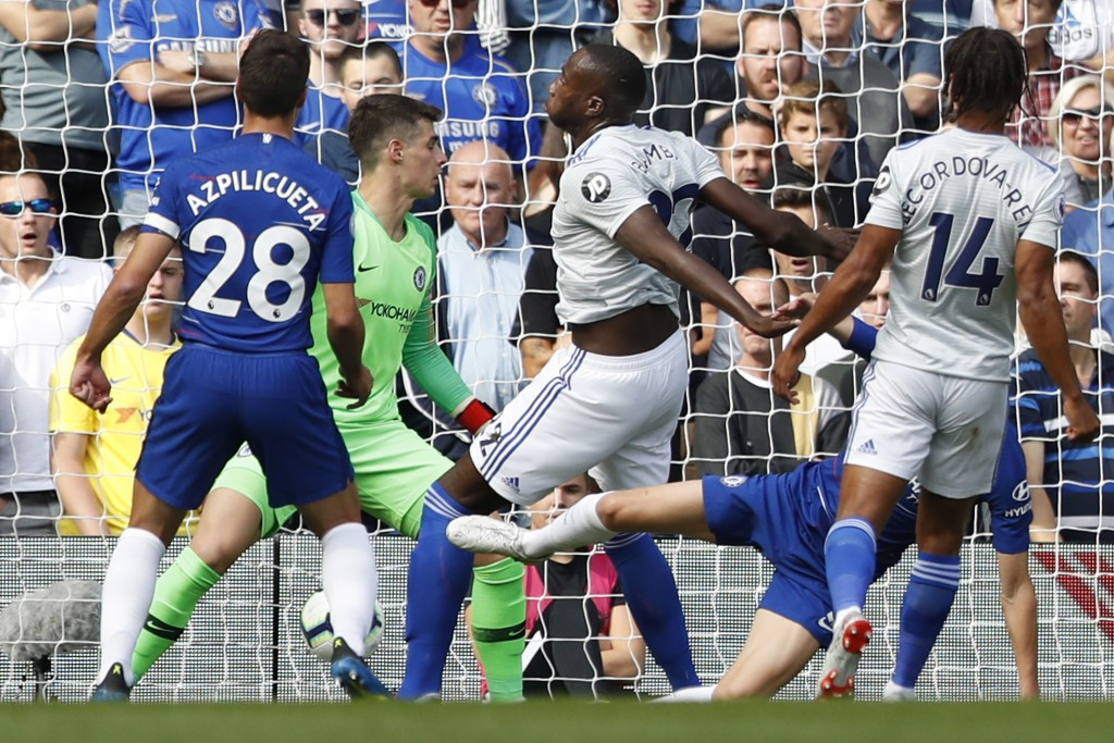 Cardiff City's Sol Bamba, center, scores the opening goal during their English Premier League soccer match between Chelsea and Cardiff City at Stamfor