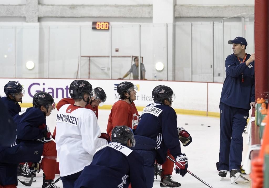 Washington Capitals head coach Todd Reirden, right, speaks to his players during NHL hockey training camp, Friday, Sept. 14, 2018, in Arlington, Va. (