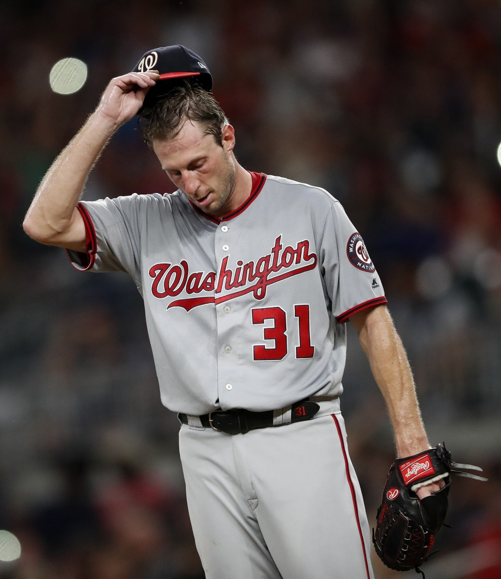 Washington Nationals starting pitcher Max Scherzer (31) paces on the mound between batters in the fourth inning of a baseball game against the Atlanta